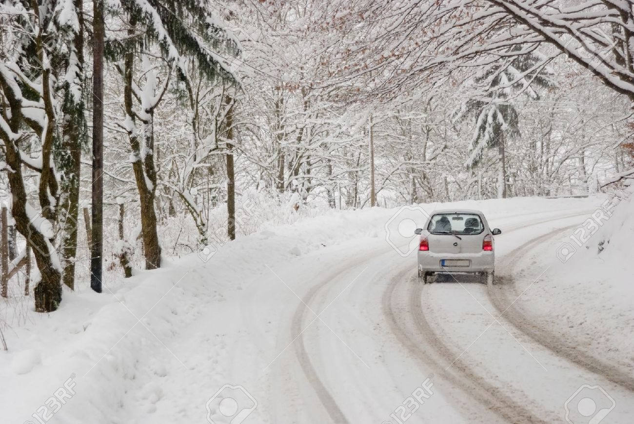 9948437-Driving-with-bad-weather-conditions-road-is-covered-by-snow-Stock-Photo