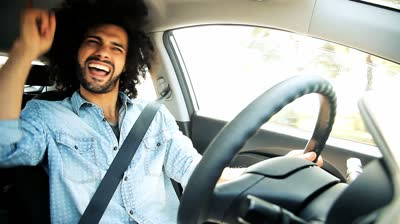 stock-footage-man-singing-and-dancing-happy-driving-car-in-city (1)